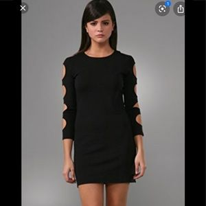 Sexy black cocktail dress with long sleeves